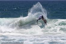Surfer carving it up at the Pi Beta Phi Surf Classic